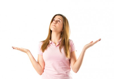 Girl having doubts over isolated white background